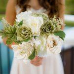 Bride holding bouquet for Summer wedding